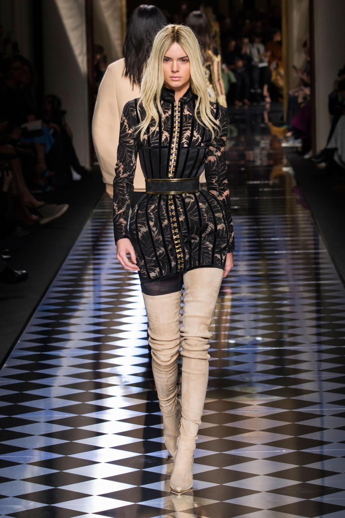 Innovative She Wears A Futuristic Metallic Tunic And Leather Thighhigh Boots With Lucite Heels Balmain Opted For An Experimental Appro